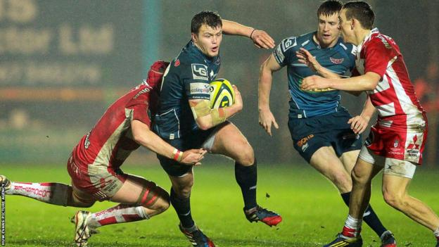 Scarlets try-scorer Steffan Hughes is tackled by Gloucester's Lewis Ludlow during the LV= Cup clash at Parc y Scarlets.