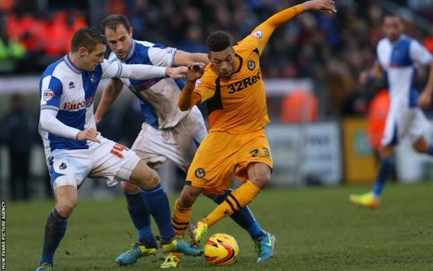 Newport County striker Christian Jolley takes on Bristol Rovers duo Lee Brown and Mark McChrystal during the Severnside derby at the Memorial Stadium.