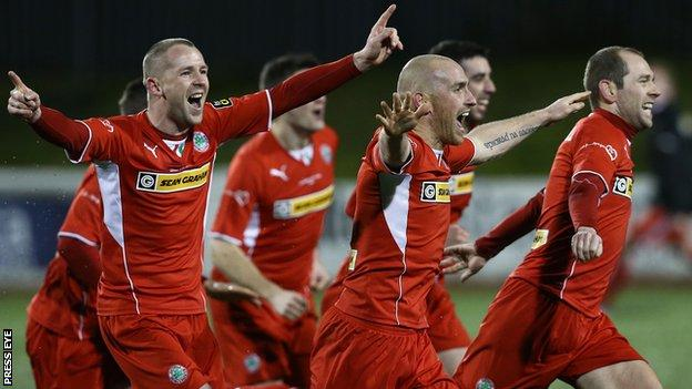 Cliftonville players celebrate the shoot-out victory