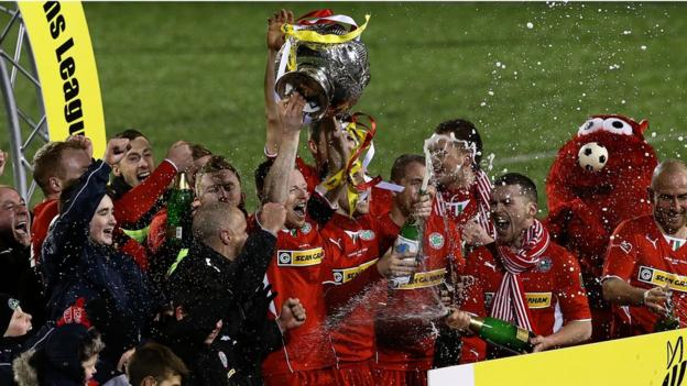 It's a champagne moment for Cliftonville as they lift the League Cup for a second year in a row