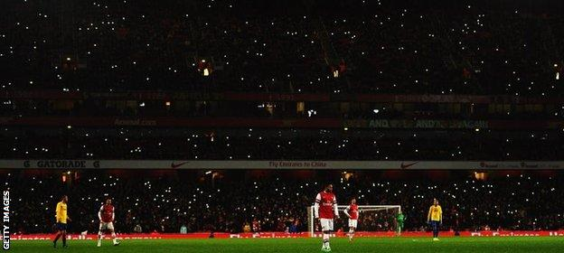 Fans with phone lights at Arsenal v Coventry