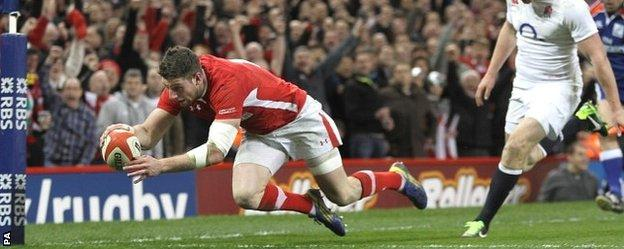 Alex Cuthbert scores one of his two tries against England in the 2013 Six Nations decider in Cardiff