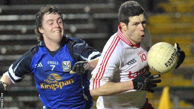 Cavan's Damien O'Reilly tracks Sean Cavanagh of Tyrone