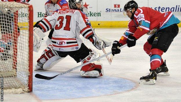 Kevin Saurette pokes in Belfast's second goal in Tuesday's first-leg win over Cardiff