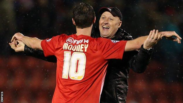 Leyton Orient manager Russell Slade embraces David Mooney