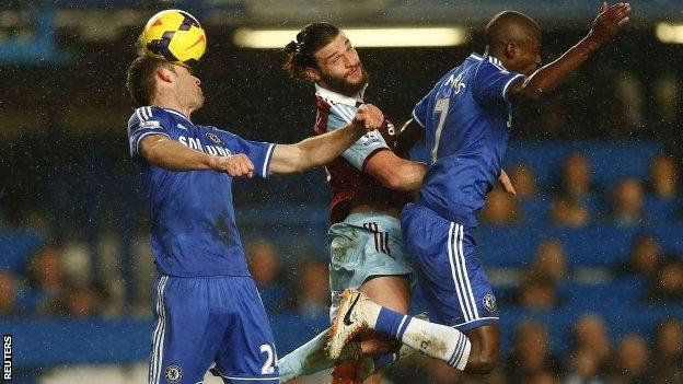 Chelsea's Gary Cahill (left) and Ramires (right) challenge West Ham United's Andy Carroll