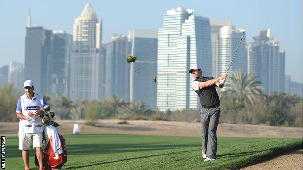 McIlroy watches his shot on the 10th hole on Thursday