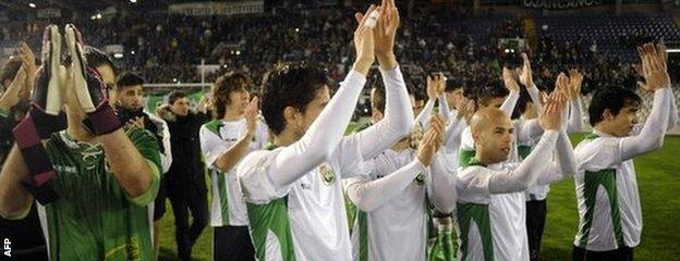 Racing Santander players salute their fans as they leave the pitch