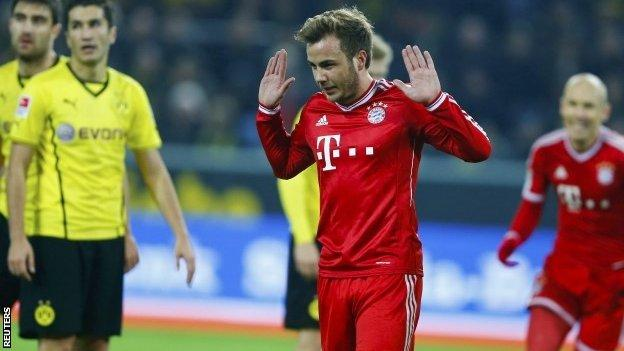 Bayern Munich's midfielder Mario Gotze gestures after scoring the 0-1 during the German first division Bundesliga football match between Borussia Dortmund and Bayern Munich