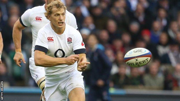 Billy Twelvetrees passes the ball for England