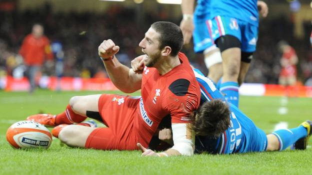 Alex Cuthbert celebrates after scoring an early try for Wales in the Six Nations match against Italy at the Millennium Stadium