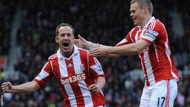 Charlie Adam celebrates after scoring Stoke's opening goal