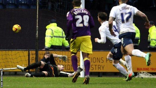 Joe Garner scores Preston's second goal from the penalty spot