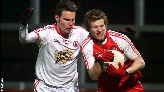 Enda Lynn tries to burst away from Ciaran McGinley at Celtic Park