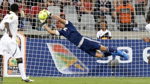 Libyas goalkeeper Nashnush saves during the African Nations Championship final