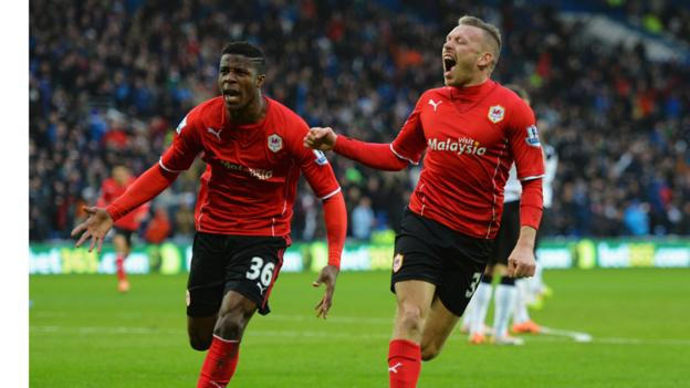 But Cardiff City equalise through Craig Bellamy who celebrates with new signing Wilfried Zaha