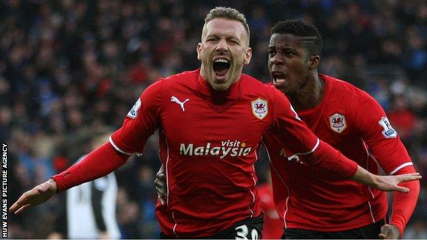 Craig Bellamy celebrates scoring an equaliser against Norwich City