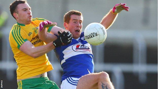 Martin McElhinney of Donegal competes for possession with Darren Strong of Laois