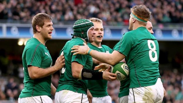 Ireland try-scorer Jamie Heaslip is congratulated by Ulster players Chris Henry, Luke Marshall and Rory Best