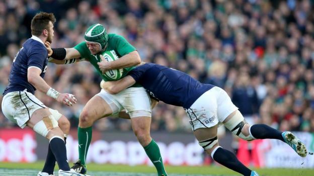 Scotland pair Ryan Wilson and David Denton combine to try and halt the progress of Irish hooker Rory Best