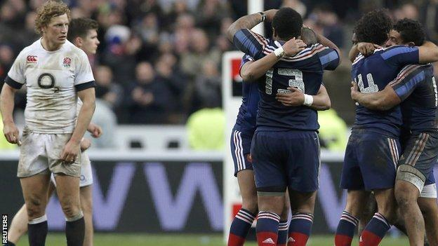 Billy Twelvetrees watches on as France celebrate