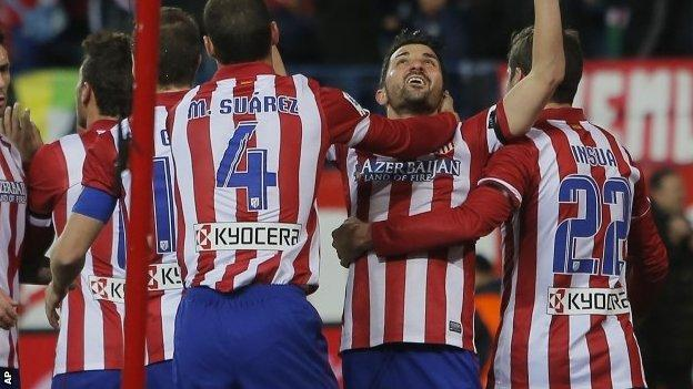 Atletico's David Villa, second left, celebrates his goal with team-mates