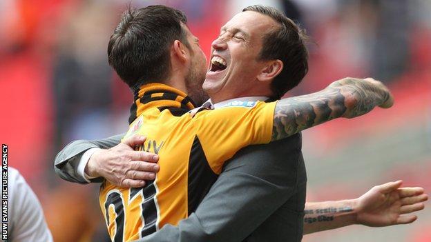 Byron Anthony embraces Newport County manager Justin Edinburgh