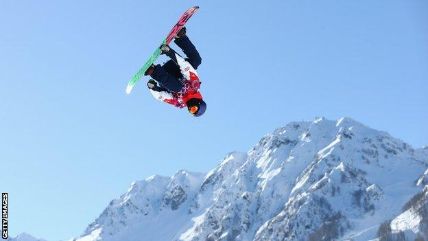 Billy Morgan performing a trick on his snowboard