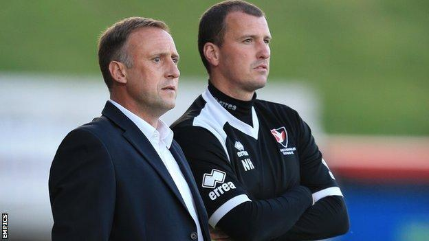 Cheltenham Town manager Mark Yates and assistant Neil Howarth