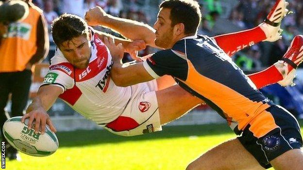 Tommy Makinson goes airborne to score a try for St Helens against Hull KR in last-season's play-offs