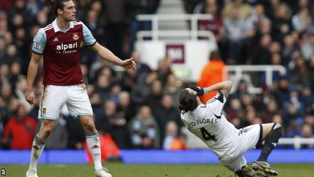 West Ham's Andy Carroll (left) and Swansea's Chico Flores