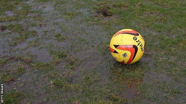 A ball on a waterlogged pitch