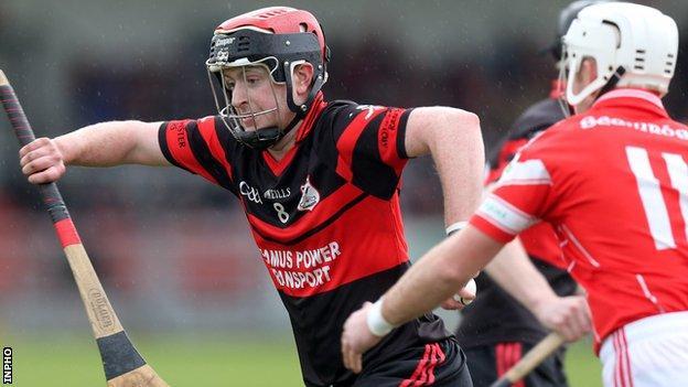 Mount Leinster's Derek Byrne in action against Declan Laverty of Loughgiel