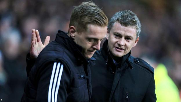 New Swansea caretaker manager Garry Monk and Cardiff boss Ole Gunnar Solskjaer greet each other before the south Wales derby