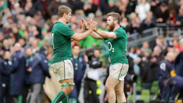 Flanker Chris Henry is congratulated by Gordon D'Arcy after scoring the first try of the game and his first for Ireland
