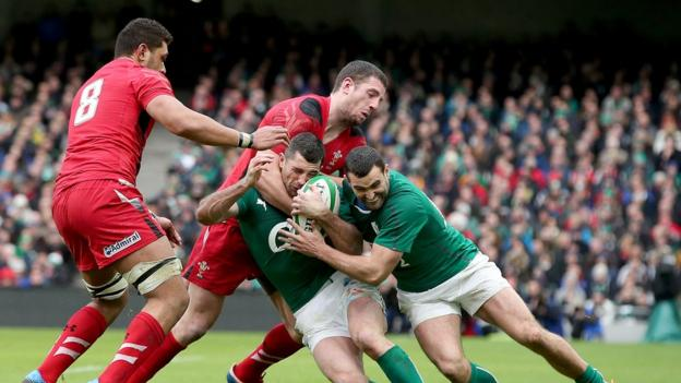 Taulupe Faletau and Alex Cuthbert come up against Ireland brothers Dave and Rob Kearney