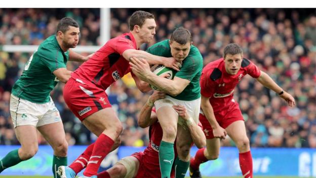 Brian O'Driscoll attempts to shrug off the attention of George North as he makes ground for Ireland