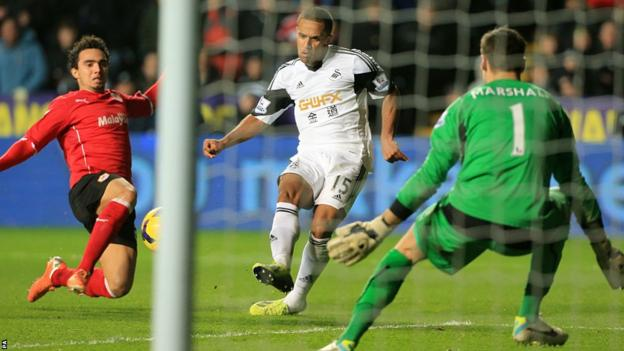 Wayne Routledge gives Swansea the lead against Cardiff