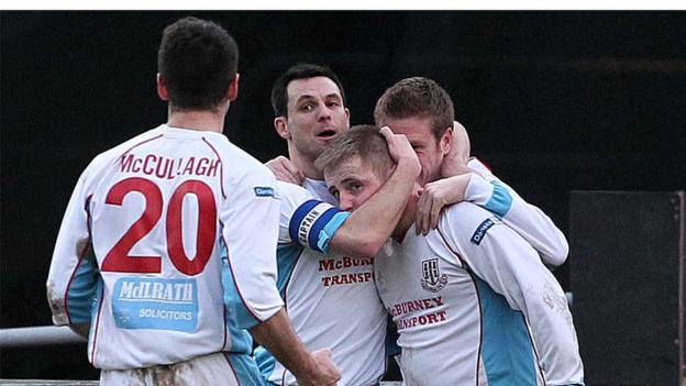 Ballymena players surround David Cushley who scored the winning goal against Linfield