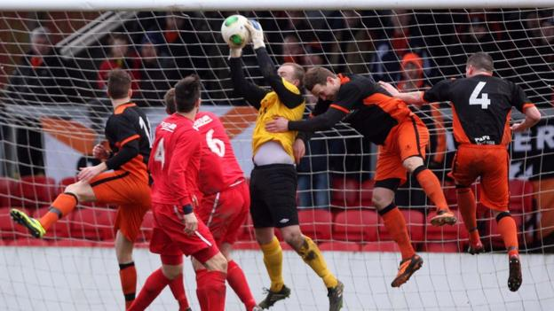 Goalmouth action from the sixth round tie between Ballyclare Comrades and Carrick Rangers