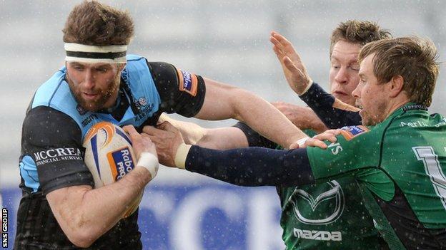 Glasgow Warriors' Richie Vernon (left) is tackled by Matt Healy