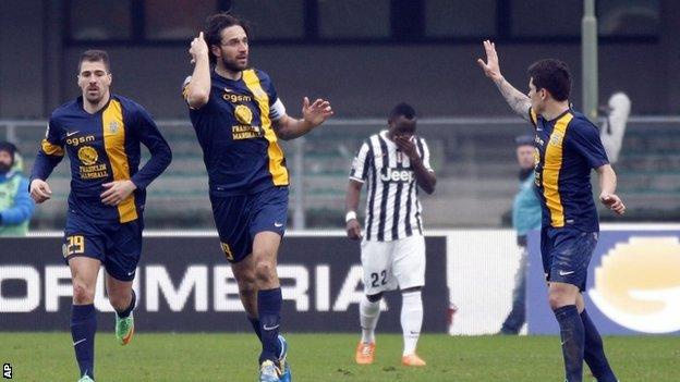 Luca Toni celebrates