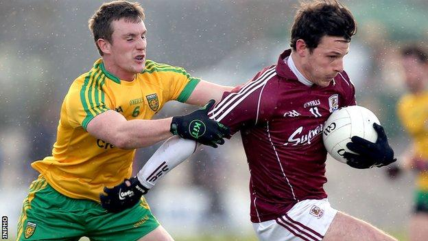 Donegal's Leo McLoone challenges Sean Armstrong of Galway