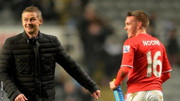 Cardiff manager Ole Gunnar Solskjaer and Craig Noone share a joke