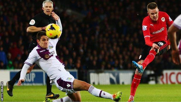 Craig Noone shoots against Aston Villa