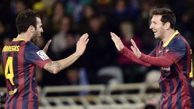 Cesc Fabregas and Lionel Messi