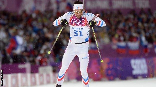 Martin Fourcade of France approaches the finish line in the men's individual 20 km