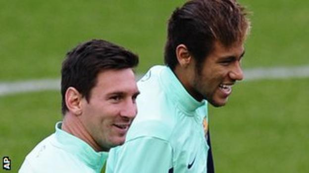 """FC Barcelona""""s Neymar, from Brazil, background and Lionel Messi, from Argentina."""