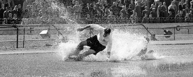 Finney splashes through a puddle during a Division One match at Stamford Bridge on 25 August, 1956