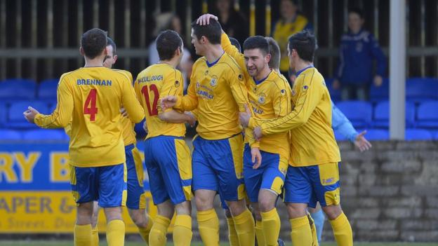 Dungannon Swifts celebrate Terry Fitzpatrick's winning goal against Warrenpoint Town at Stangmore Park